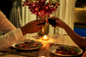 Happy couple on summer evening having romantic dinner.